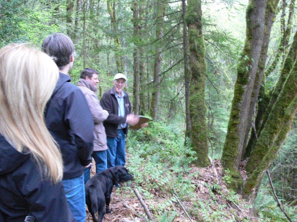 Dave Kappler points out sensitive areas as he guides Councilman Dunn on a hike through the forest area